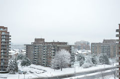 Condo buildings in snow in Montreal downtown Stock Photos