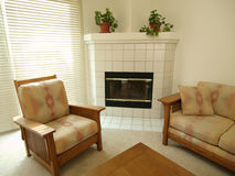 Condo Fireplace. A fireplace, chair and sofa inside a California Townhouse Stock Photos
