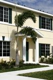 Condo with Green Shutters royalty free stock image
