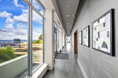 Condo hall interior with luxurious deck overlooking Seattle. Stock Images