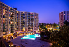 Condo living in McLean, VA. View of McLean House condominium and pool at night Royalty Free Stock Photography