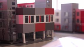 Condo Paper Model. Paper models of condominium and city dwelling houses. Architecture, design and real estate concept stock video footage