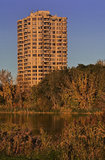 Condo in the sunset. A condo building in a natural environnement with trees and a river just in front of it shot in the sunset light Royalty Free Stock Image