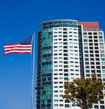 Condo Tower and Flag Stock Photography