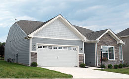 Condo with Two-car Garage. Small gray condo with attached two-car garage royalty free stock photography