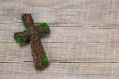 Condolence: wooden handmade cross on a background. Stock Photos