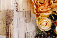 Condolences background, artificial flowers and autumn plants Royalty Free Stock Image
