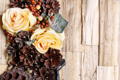 Condolences background, artificial flowers and autumn plants. Stock Photos