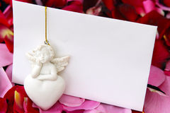 Condolences, consolation card. A love letter with rose petals and angel stock photography