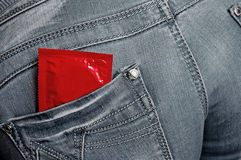 Condom. In jeans back pocket stock images