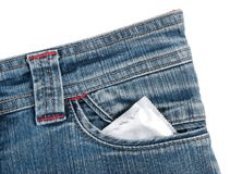 Condom. In a jeans pocket stock images