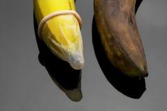 Condom and banana Royalty Free Stock Images