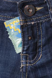 Condom in the blue jeans. Condom in a fly a pants Royalty Free Stock Photo
