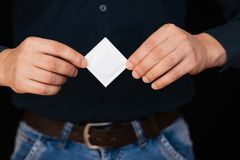 Condom for contraception and protection in male hands. Close-up stock photography