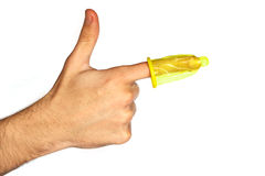 Condom on a finger Stock Photos