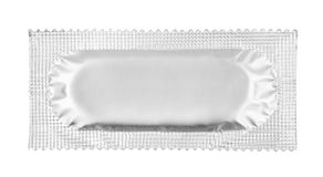 Condom. Isolated on white background royalty free stock photography