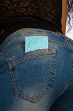 Condom in jeans pocket Stock Photos