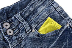 Condom in a jeans pocket Stock Photos