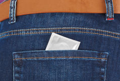 Condom in jeans pocket Stock Images