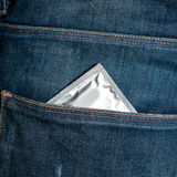 Condom in jeans pocket Royalty Free Stock Image