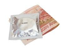 Condom with money Stock Photo