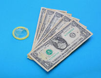 Condom with money Royalty Free Stock Photography
