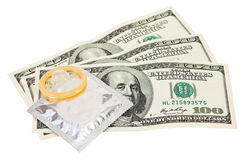 Condom with money on white Royalty Free Stock Photo
