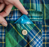 Condom. One condom in the pocket stock photography