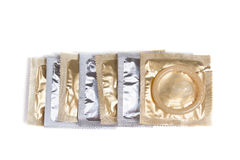 Condom packs on a white background Royalty Free Stock Photo