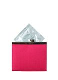 Condom in a pink wallet Royalty Free Stock Photo