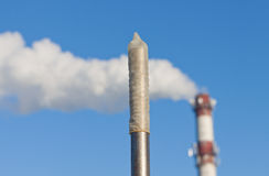Condom on pipe against pollution pipe. Stock Photography