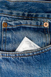 Condom in the pocket of a blue jeans stock image