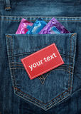 Condom in pocket with red paper Stock Image