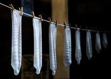 Condomen in verschillende grootte Stock Fotografie