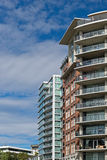 Condominium or apartment building. Tall condominium or apartment building in the city downtown Royalty Free Stock Images