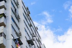 Condominium buildings on a sunny day against  blue sky and cloud. royalty free stock photography