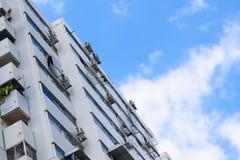 Condominium buildings on a sunny day against  blue sky and cloud. stock photos