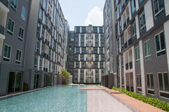 Condominium with pool Royalty Free Stock Images