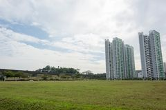Condominium skyline with trees, grasses and lrt train and railroad royalty free stock images