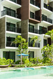 Condominium and swiming pool life of City people in modern town Stock Photography