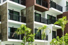Condominium and swiming pool life of City people in modern town. Royalty Free Stock Photos