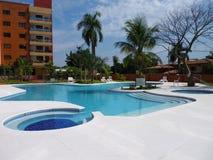 Condominium with swimming pool Stock Photos