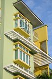 Condominium units. A photo taken on a couple of condominium units painted in yellow and green and with clear blue casement windows stock photo
