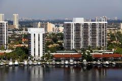 Condominiums with private boat docks. View of condominiums with private boats parked in canal. Location: Miami Florida Stock Photo