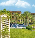 Condominiums and Palm Trees. Parking area view of condominiums at a beach resort stock photography