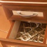 Condoms in desk drawer Stock Image
