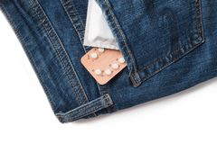 Condoms in package in jeans. Safe sex concept. Healthcare medicine, contraception and birth control. Close Up oral contraceptive pills. Protection against Stock Images