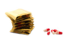 Condoms and pills (tablets) Royalty Free Stock Photos