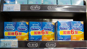Condoms on the storage racks for sale Royalty Free Stock Photos