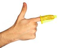 Condoom op een vinger stock foto's